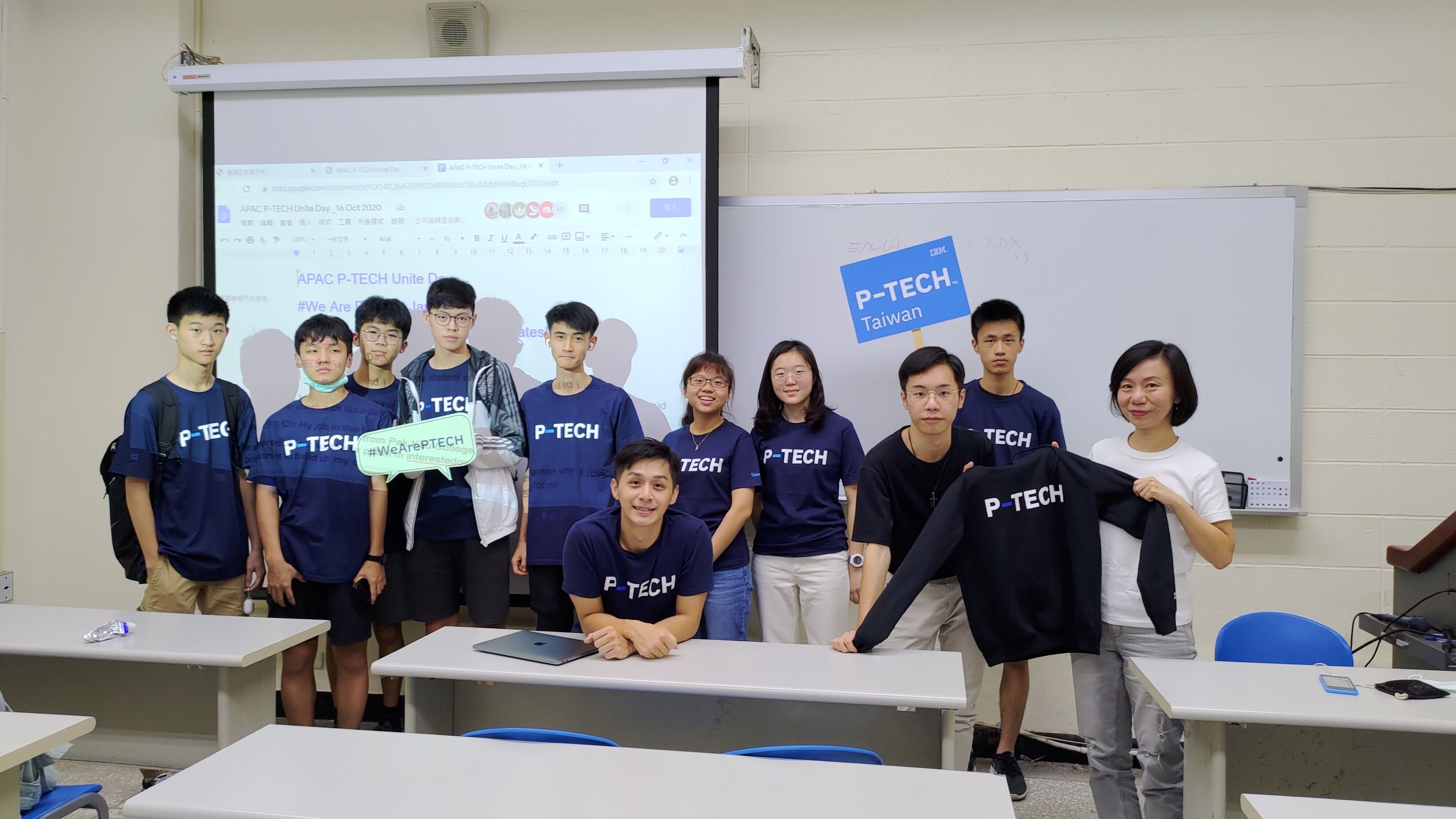 Classroom with 10 P-TECH students and one mentor posing for the picture.