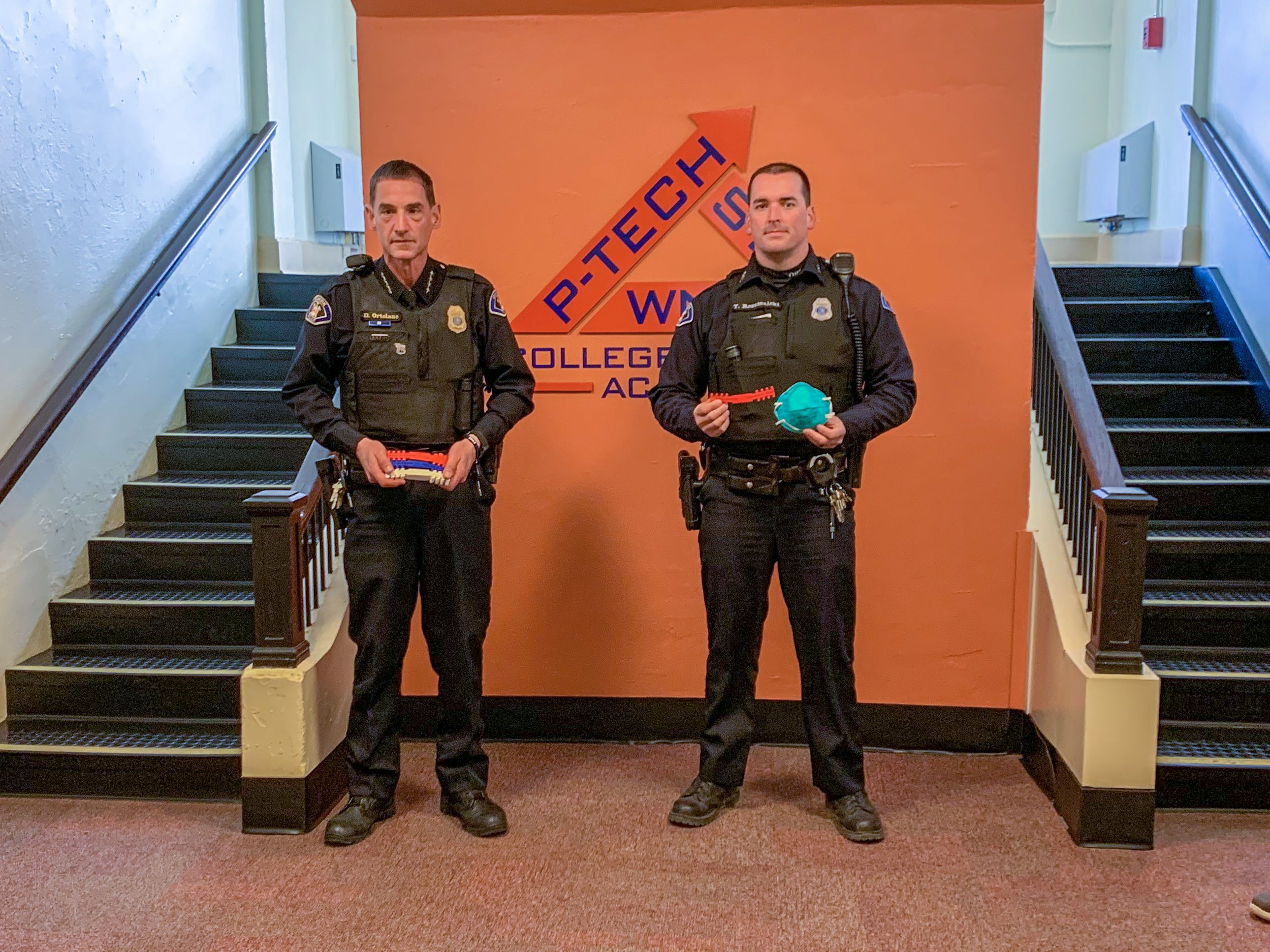 WNY P-TECH College and Career Academy donated more than 220 specially-designed ear guards to the Dunkirk Fire Department, Dunkirk Police Department, Brooks Memorial Hospital, Elliot Hospital in New Hampshire and Mount Sinai Hospital in New York City. Accepting the donation on behalf of the Dunkirk Police Department were Chief David Ortolano and officer Thomas Rozumalski. Pictured, from left, are Matt Edwards, P-TECH math teacher; Ortolano; Rozumalksi; and Nick Anson, P-TECH CADD teacher.