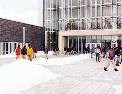 Picture of Chicago Academy entrance showing students and snow on the ground