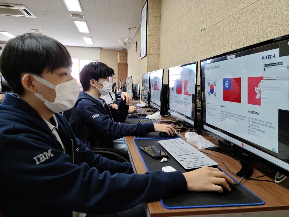 P-TECH Student wearing face mask and looking at his computer